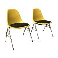2 DSS Yellow Fiberglass Stacking Chairs & Pillow